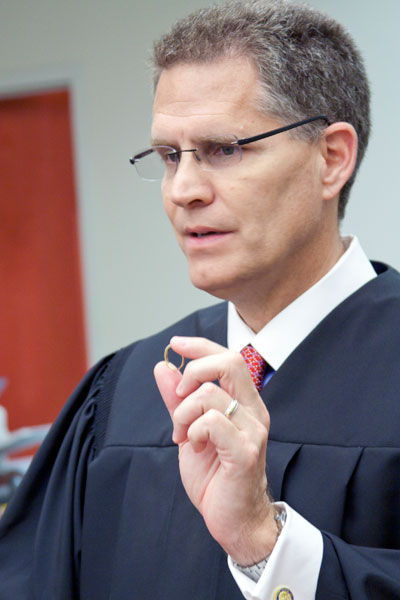 Judge Gravell holding a ring.